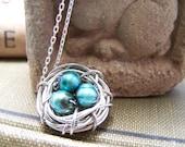 Bird Nest Pendant in Silver with Three Blue Eggs...Mother Bird