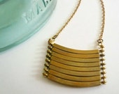 Brass geometric necklace with military style curved brass bars. Stacked bar necklace.