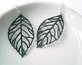 Black leaf earrings on sterling silver earwires.
