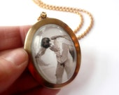 Nude dude necklace. Portrait art. Statement necklace. Large gold oval. After a bath, 1907.