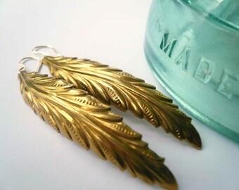 Feather earrings. Long brass gold dangle earrings on 14K gold fill ear wires.