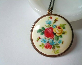 Garden rose necklace. Romantic red blue and yellow flower cameo necklace. Round pendant on a brass chain.