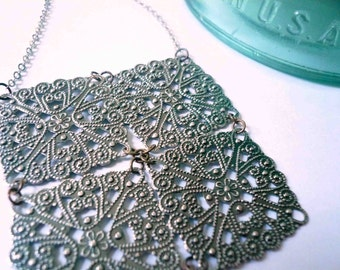 Geometric jewelry. Antiqued silver necklace of filigree blocks.