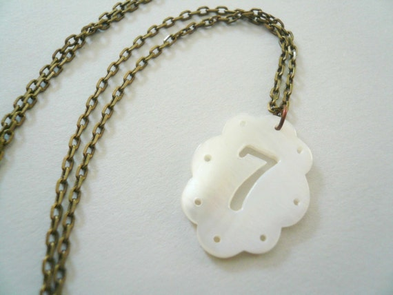Lucky Seven Necklace. White shell necklace on antiqued brass chain. Do you feel lucky...