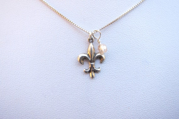 Sterling fleur de lis with champagne crystal