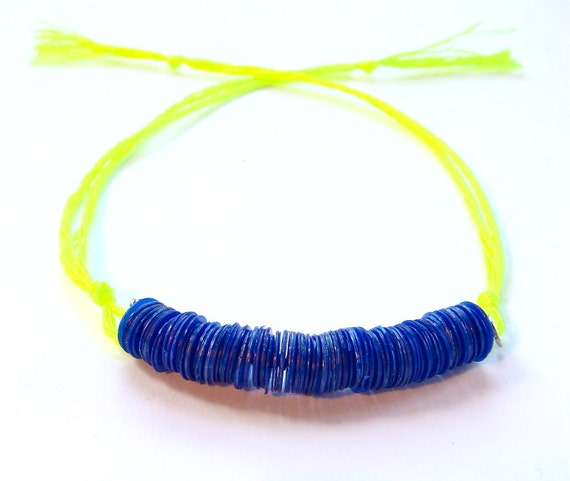 kaleidoscope in neon yellow // bracelet with 6mm royal blue opaque sequins on neon yellow string