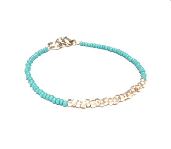 SALE /////// heartlines in turquoise & silver // dainty bracelet with mini geometric silver beads on background of turquoise seed beads