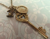 Into Wonderland. Charms Necklace. Alice in Wonderland Inspired. Vintage Key, Clock and Rabbit. Antique Brass Tone.