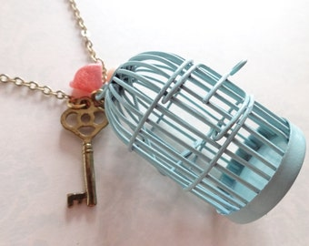 He Got Away. Light Blue Bird Cage with Key, Pink Flower and Fresh Water Pearl Necklace.