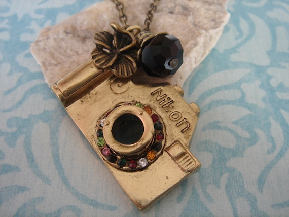 Picture Perfect. Camera necklace with flower charm (Antique tone)