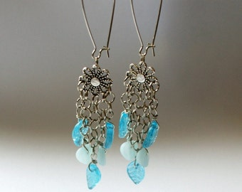 Daisy and flying aqua leaves earrings
