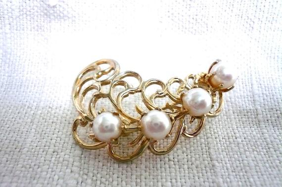 https://www.etsy.com/listing/75768924/vintage-pearl-brooch-1950s-leaf-swirl