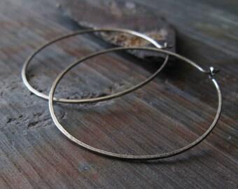 Minimalist brushed thin sterling silver handmade hoop earrings. Rustic gift. Modern artisan wirework. Lightweight simple everyday jewelry.