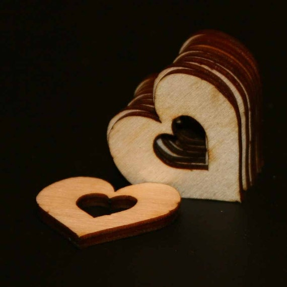 12 - Heart Cutout - 1-1/2 with .5 inch heart cutout x 1/8 inch unfinished wood (HRTC-1.25)