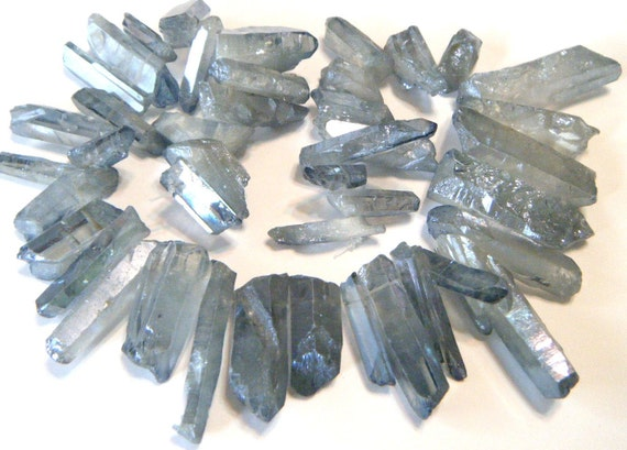 Natural rock crystal points druzy type coated smoky blue color