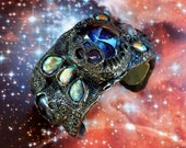 Worm Hole Portal Alien Ship Control Cuff made with polymer clay, gemstones and glass gems