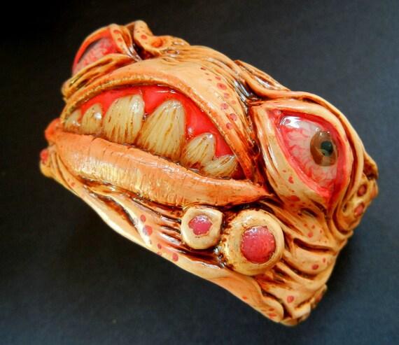 Polymer clay creepy creature cuff bracelet