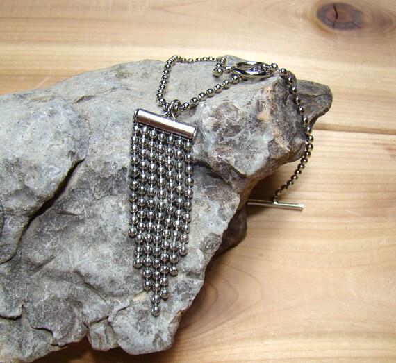Bracelet Classy Little Tassel Bracelet - Understated 80s on Etsy