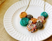 Lee Lynn  -  Teal, Orange, and brown  rosette bib statement necklace