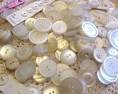 A nice collection of small, medium, large white, off-white, clear, and cream vintage buttons, a couple mother of pearl buttons