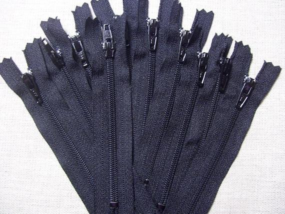 Clearance - Ten 4 Inch black YKK zippers.