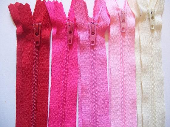 Ten 12 inch YKK zippers -2 red, 2 hot pink, 2 medium pink, 2 light pink, and 2 vanilla YKK zippers