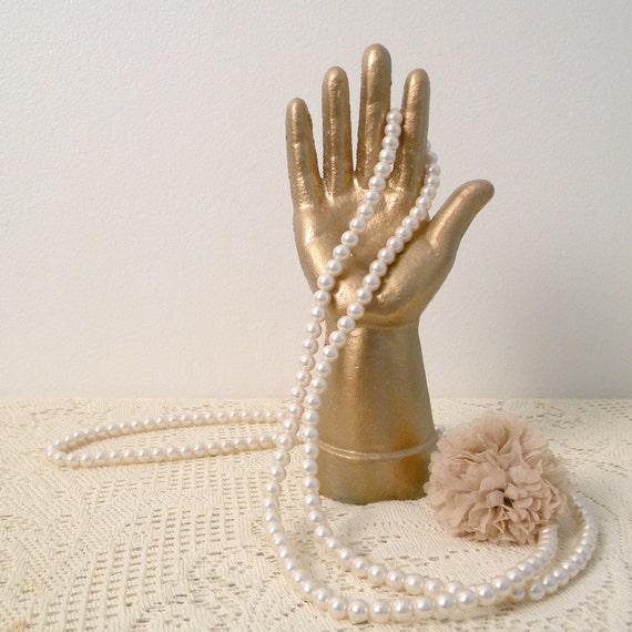 golden cast iron hand statue