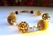 Gold beaded Bracelet , Swarovski crystal beads and Gold elements , Golden yellow beads
