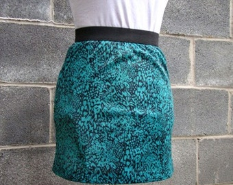 Upcycled tight street chic mini skirt green and black printed with elastic waist - small