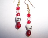 Skulls with red beads earrings