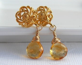 Golden Citrine earrings wire wrapped with goldfilled on Bali Vermeil flower post