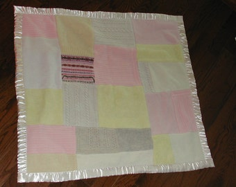 recycled wool baby blanket with satin trim and backed with polar fleece