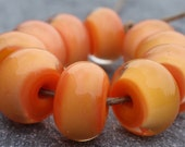 Apricot yellow encased with clear - 10 handmade lampwork beads