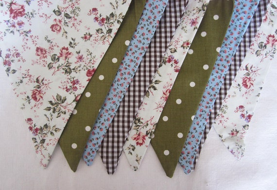 Bunting, Flags the fabrics are mainly Olive Green,Chocolate Brown and Pale blue in Spots, Flowers and Gingham and its  3m long.