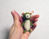 Tiny Green and White Mouse