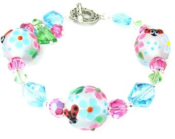 Ladybug Bracelet, Garden Bracelet, Lampwork Bracelet, Floral Bracelet, Pastel Blue Glass Bracelet, Ladybug Jewelry  Ladybugs in the Garden