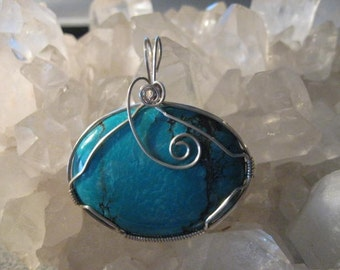 Beautiful torquoise pendant wrapped in sterling silver