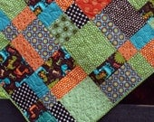 baby boy quilt for toddler bed or throw // dinosaur hopscotch in bright boy fabrics