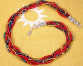 Red, gold and multicolored braided necklace.