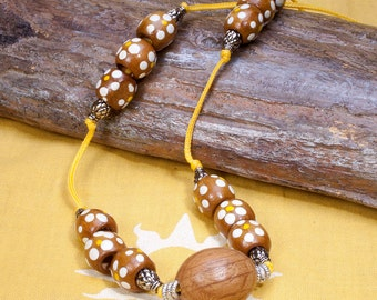 Wood bead necklace, brown, yellow and white, Chinese cord and Tibetan silver beads.