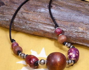 Wood bead necklace knotted on cord, brown, black and silver.