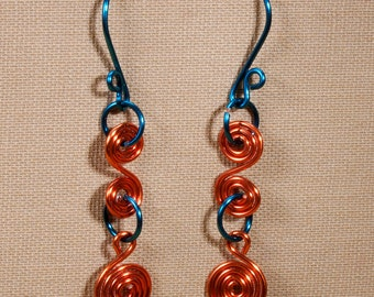 Orange and blue earrings, spiral earrings in peacock blue and orange.