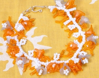 Pale blue orange white beadwoven bracelet, lucite flowers and Sterling clasp.