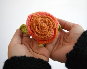 Crochet flower brooch orange