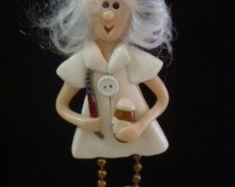 Nurse Good Body: Polymer Clay nurse pin holding medicine & thermometer