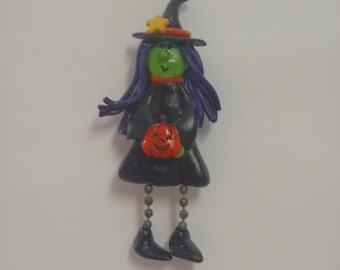 Witchy Poo: Polymer Clay witch pin with pumpkin charm and various charms on her hat