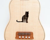Ukulele (customizable sound hole of choice) Example: Cat
