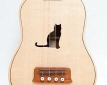 Ukulele (customizable sound hole of choice) Example: Cat