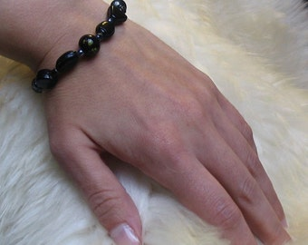 20% OFF Black beads bracelet with a clasp