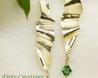 """Sterling Silver freeform dangle earrings with green Swarovski crystal. They are called """"Ribbons."""""""